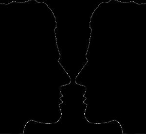 Jekyll and Hyde vis a vis: Abbildung von zwei Gesichtern im Profil, die sich gegenseitig ansehen
