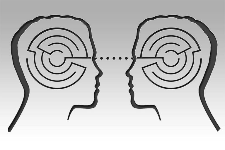 Abbildung zweier schamatischer, sich gegenüberstehender Gesichter im Halbprofil. Die Köpfe sind jeweils mit einem Labyrinth belegt, die mittels einer direkten Linie verbunden sind.